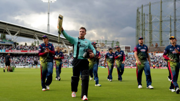 Jason Roy walks back after his century
