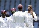Roston Chase celebrates after picking up a wicket, West Indies v India, 3rd Test, Gros Islet, 1st day, August 9, 2016