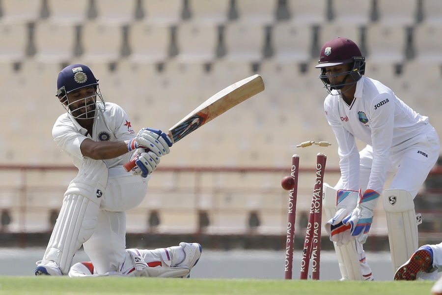 Rahane buckled down in the company of R Ashwin to try and get India back on track, before his wicket, two overs before tea, gave West Indies control again
