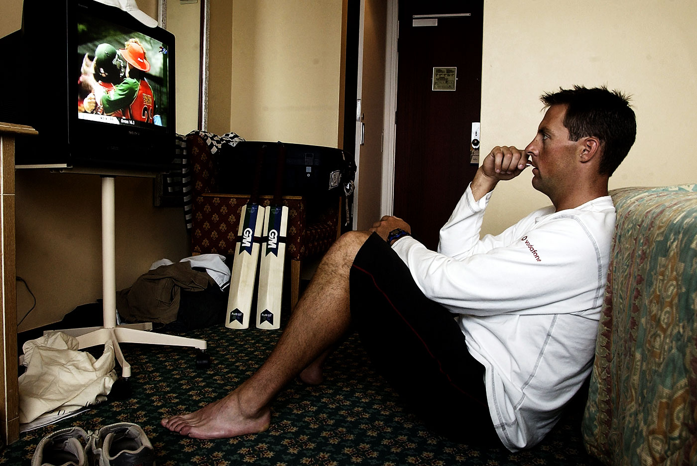 Marcus Trescothick watches a match on TV in his hotel room in Port Elizabeth during the 2003 World Cup