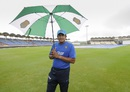 Anil Kumble takes shelter under an umbrella, West Indies v India, 3rd Test, Gros Islet, 3rd day, August 11, 2016
