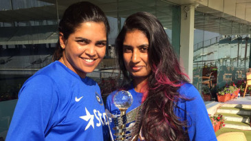 Veda Krishnamurthy and Mithali Raj pose with the trophy