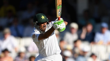 Younis Khan leaps to turn the ball to leg