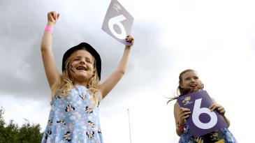 Young fans celebrate a boundary