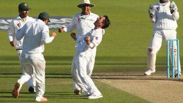 Yasir Shah celebrates taking the key wicket of Joe Root