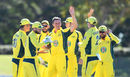 Chris Tremain is congratulated by his team-mates after picking up his fifth wicket, Australia A v India A, quadrangular series, Townsville, August 14, 2016