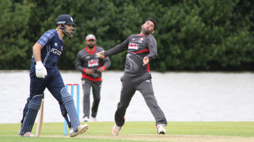 Mohammad Naveed runs in to bowl