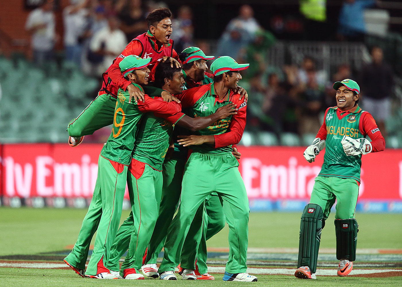 Bangladesh players celebrate after beating England