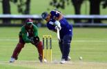 Sri Lanka Under-19 batsman Prasad Ranawaka drives a delivery down the ground on the leg side during his innings of 28. Wicket-keeper Gareth Matthew looks on. ICC Under-19 World Cup Super League Group 1: Sri Lanka Under-19s v West Indies Under-19s at Hagley Oval, Christchurch, 31 January 2002.