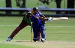 Sri Lanka Under-19 batsman Prasad Ranawaka misses an attempted sweep during his innings of 28. Wicket-keeper Gareth Matthew looks on. ICC Under-19 World Cup Super League Group 1: Sri Lanka Under-19s v West Indies Under-19s at Hagley Oval, Christchurch, 31 January 2002.