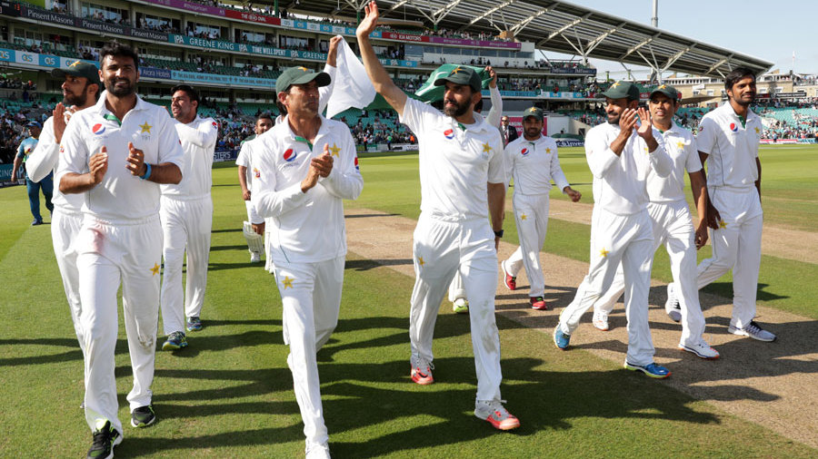 Misbah-ul-Haq leads his players in a lap of honour
