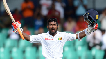 Kaushal Silva roars his delight after battling through a split webbing to score a crucial century