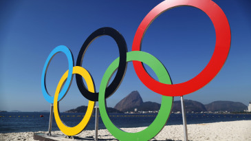 The Olympic rings on a beach in Rio de Janerio