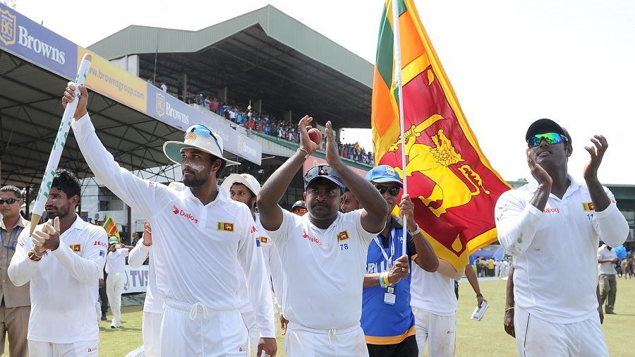 Dinesh Chandimal, Rangana Herath and Angelo Mathews during a lap of honour