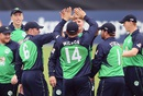 Barry McCarthy celebrates with team-mates after picking up one of his four wickets, Ireland v Pakistan, 1st ODI, Malahide, August 18, 2016