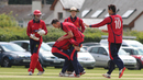 Anthony Hawkins-Kay lifts up Rob McBey after one of McBey's three wickets, Jersey v Guernsey, ICC World Cricket League Division Five, St Martin, May 25, 2016