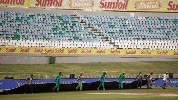 Ground staff bring on the covers at Kingsmead