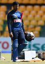 Avishka Fernando walks with his batting equipment during training, Colombo, August 20, 2016