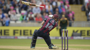 Swinging hard: Rob Keogh loses his bat