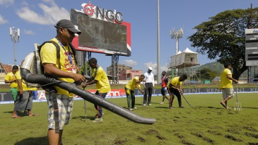 Ground staff opened up the outfield with a pitch fork and used a blower to aid the drying process