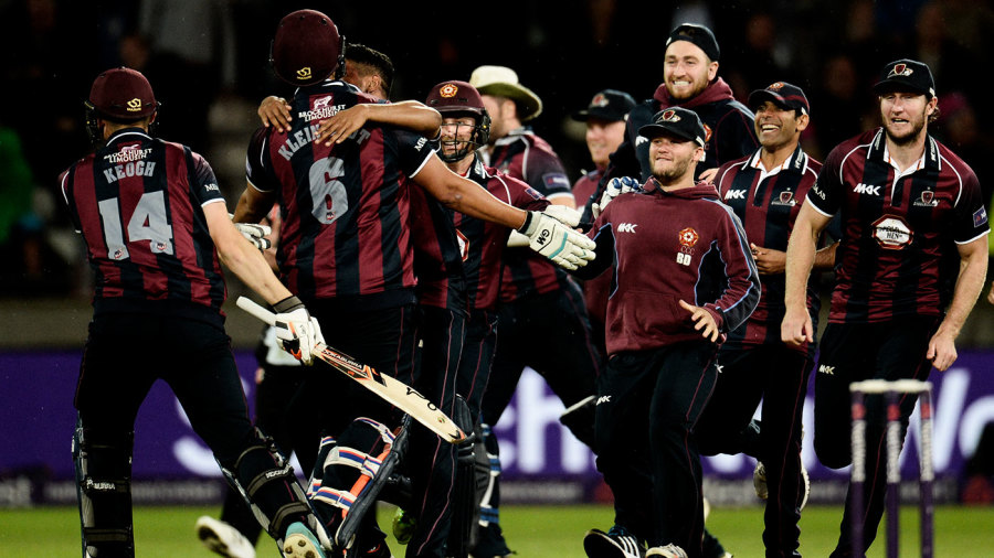 The Northants players run on to the field to celebrate victory