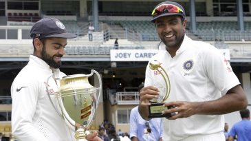 Virat Kohli poses with the series trophy, R Ashwin with the Man-of-the-series award