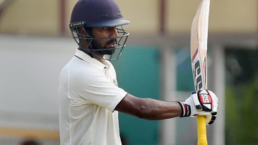 Abhinav Mukund raises his bat after scoring a fifty
