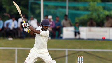 Abhinav Mukund drills the ball through the off side