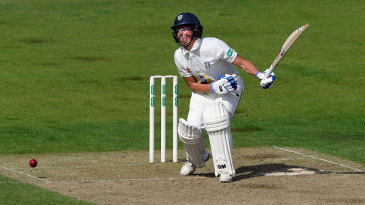 Michael Richardson takes a blow during his half-century