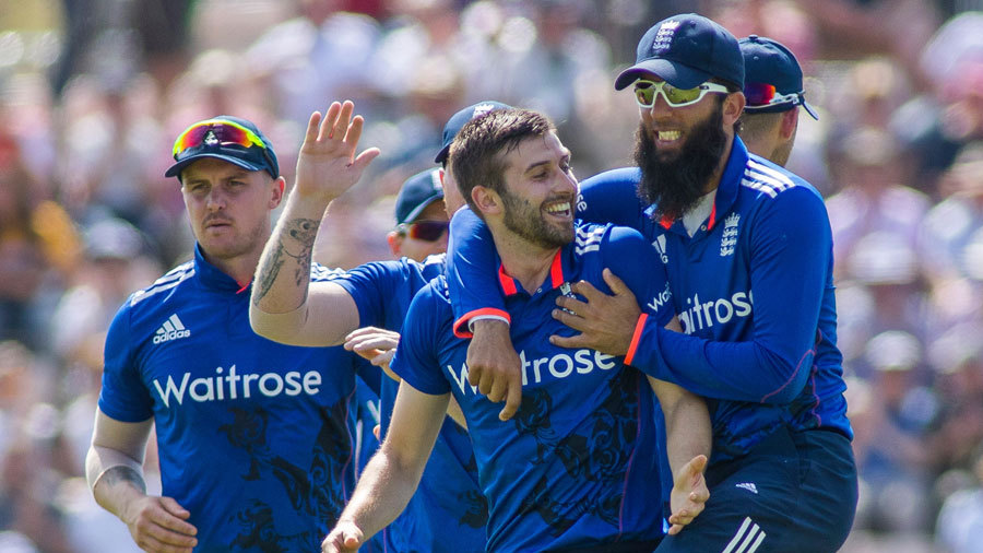 Mark Wood was mobbed by his team-mates after striking on his England comeback