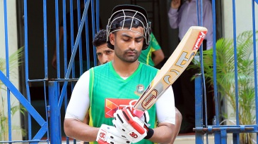 Tamim Iqbal walks out to bat during Bangladesh's training session