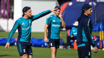 Jos Buttler points the way during England training