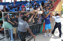 Security guards hold up a fence from collapsing under the weight of fans desperate for a selfie with Rohit Sharma, Lauderhill, August 26, 2016