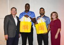 Carlos Brathwaite and MS Dhoni receive gift bags at a welcome reception in Florida, Fort Lauderdale, August 26, 2016