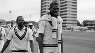 Curtly Ambrose and Malcolm Marshall walk back after sharing ten wickets between them in England's first inning