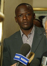 Maurice Odumbe and his lawyer in court, June 19, 2004