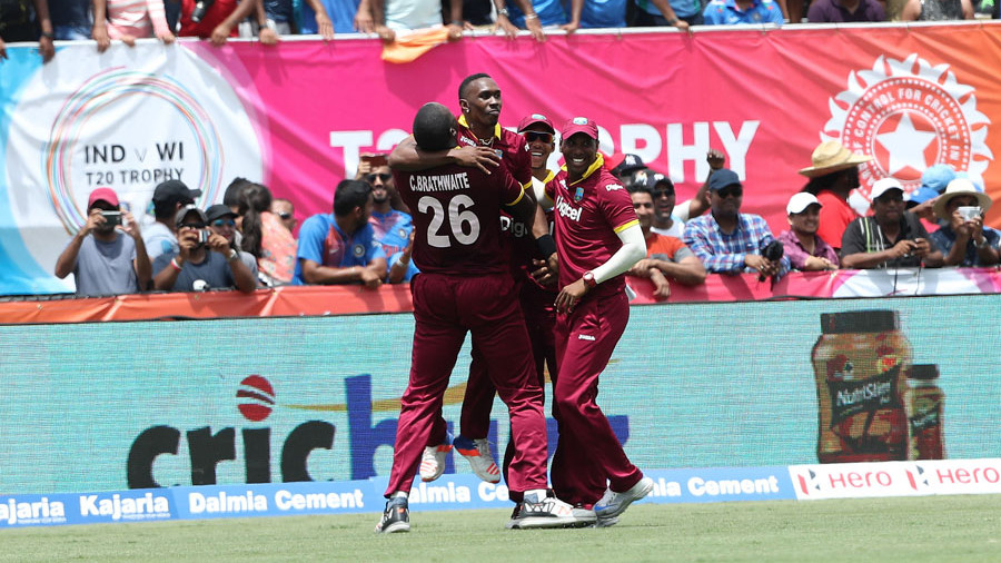 Dwayne Bravo exults with his team-mates after West Indies' one-run win