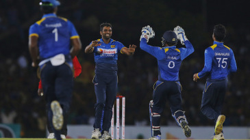 Dilruwan Perera is all smiles after removing Travis Head