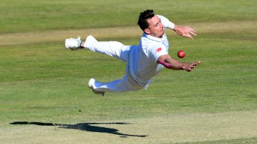 Dale Steyn is air borne while trying to stop the ball