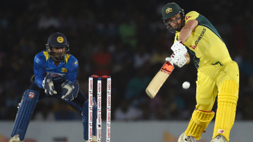 Aaron Finch shapes up to thwack the ball