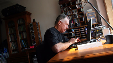 Ian Chappell works in the study of his home in Sydney