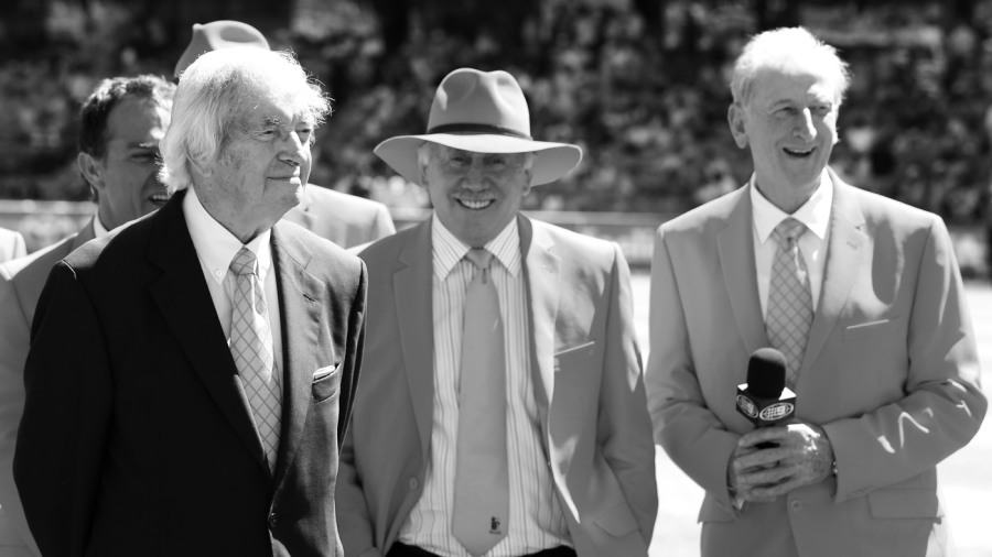 Richie Benaud, Ian Chappell and Bill Lawry watch a presentation by the McGrath Foundation during tea in Sydney