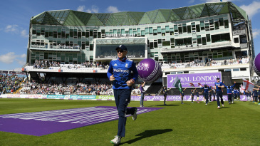 Eoin Morgan walks his team out