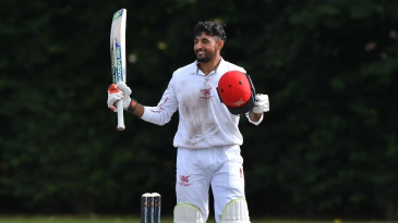 Nizakat Khan celebrates his hundred