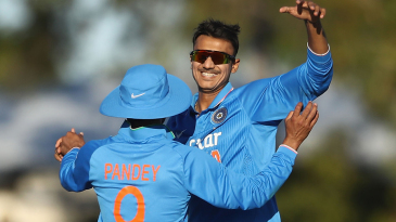 Axar Patel celebrates a wicket with Manish Pandey