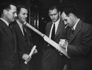South Africa cricketers (L-R) Ken Viljoen, Athol Rowan, Lindsay Tuckett and Jack Plimsoll sign a bat, London, September 11, 1947