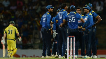 Sri Lanka's players get together after dismissing David Warner