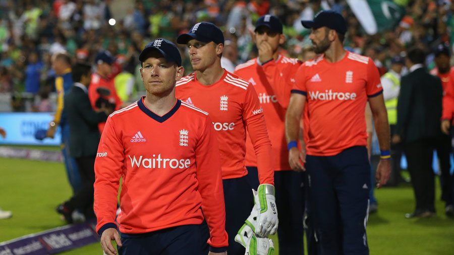 Eoin Morgan leads his beaten team from the field