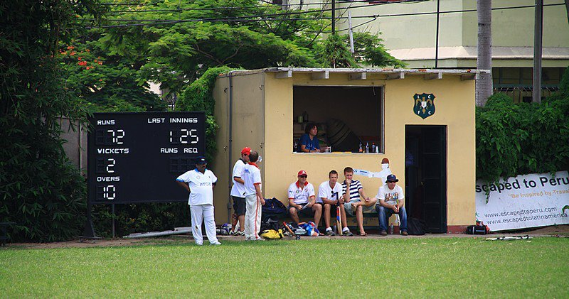 Players wait for their turn to bat at the Lima Cricket and Football Club