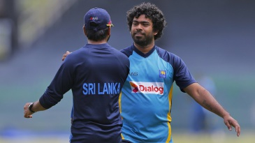 Lasith Malinga is greeted by trainer Dilshan Fonseka